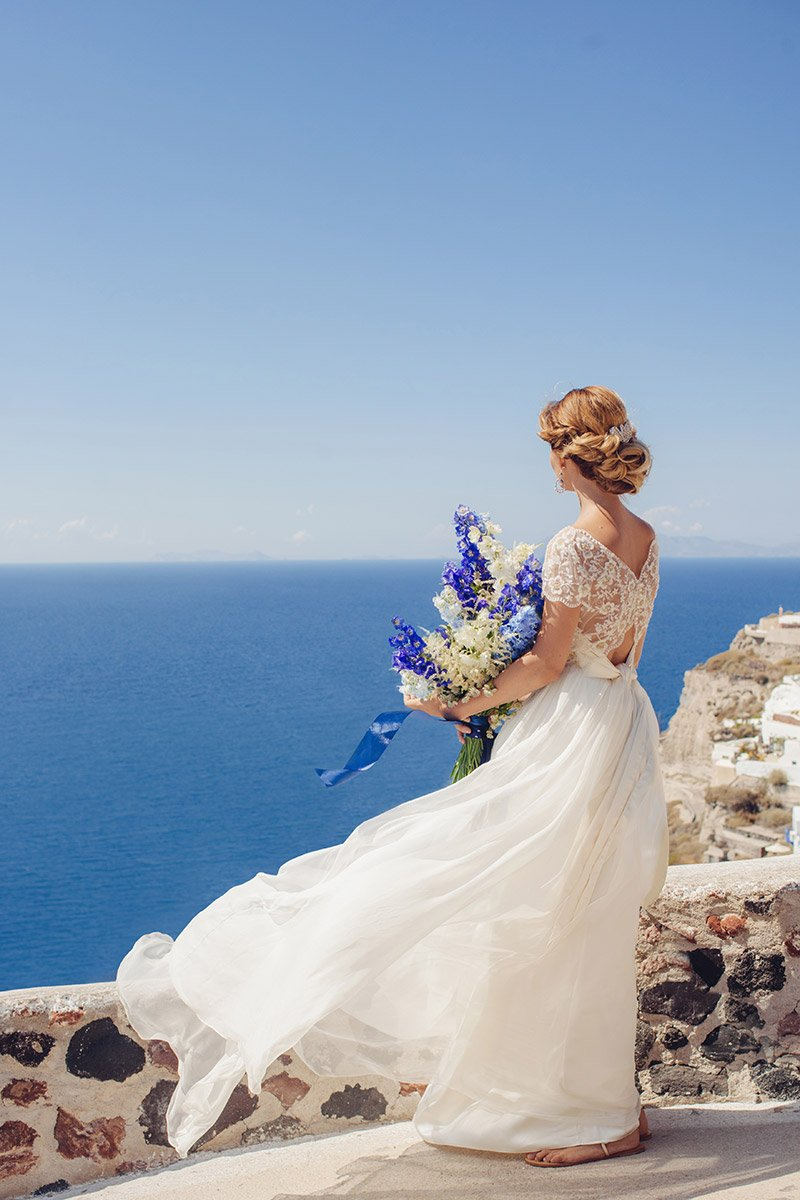 Wedding in the hues of white and blue in Santorini by Fabio Zardi